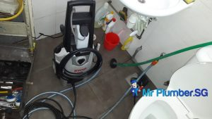 Clearing-of-floor-trap-choke-plumber-singapore-Commer
