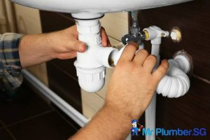 man-fixing-pipes-hdb-plumber-mr-plumber-singapore