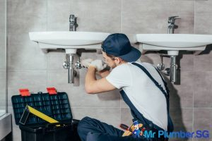 plumbing-contractor-doing-repairs-green-plumbing-mr-plumber-singapore